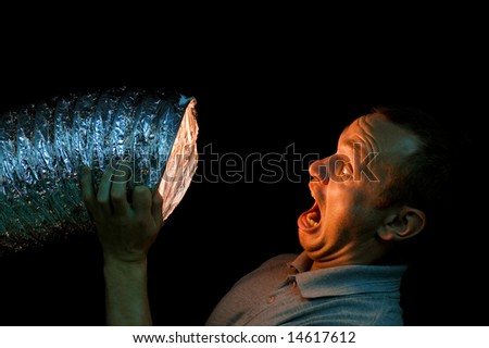 The man loudly shouts - stock photo