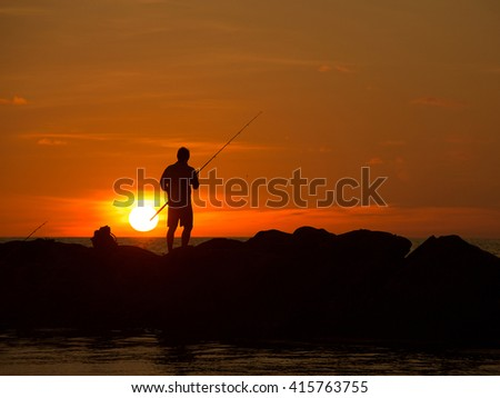 The man of fishing at the sunset