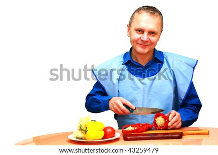 The man offers vegetables on a plate - stock photo