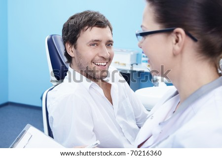 The man on reception at the dentist - stock photo