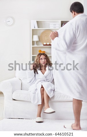 The man opened its coat to a woman - stock photo
