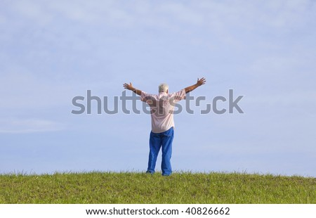 The man opens his arm, enjoy the fresh air and embrace the nature. - stock photo