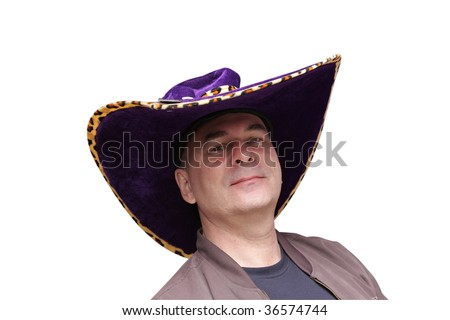The man poses in a cowboy hat on white background - stock photo