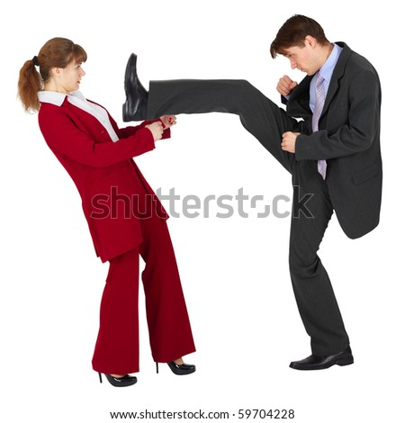 The man puts a kick to the woman - stock photo