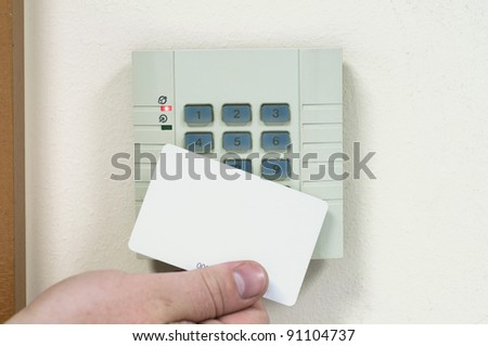 The man puts the card into the reader - stock photo
