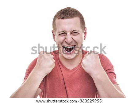 The man rejoices victory holding up fists. - stock photo