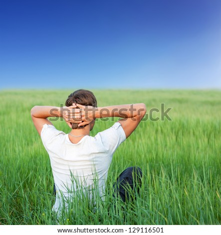 The man relaxing outdoor - stock photo
