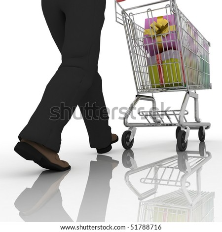 The man rolls the store cart with gifts - stock photo