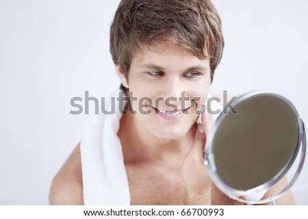 The man rubs the face with cotton pad - stock photo
