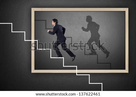 The man run upwards on a ladder - stock photo