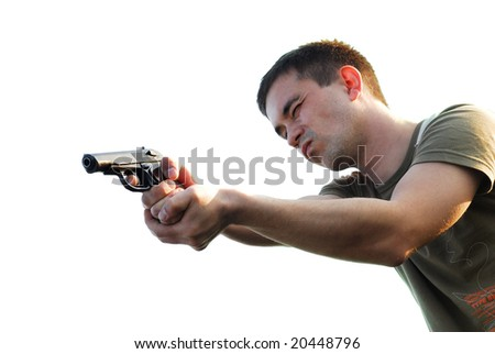 The man shoots from a pistol on a white background