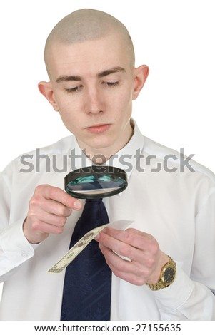 The man studying a counterfeit money by means of a magnifier - stock photo