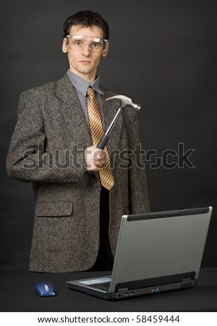 The man was determined to repair the computer with their own hands - stock photo