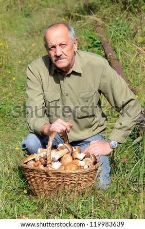 The man with a basket of mushrooms