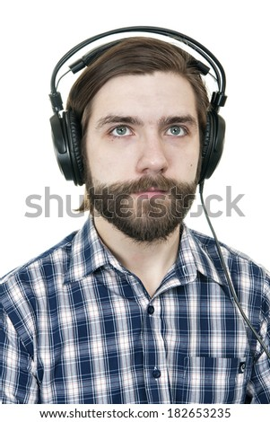 the man with a beard in earphones