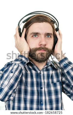 the man with a beard in earphones - stock photo