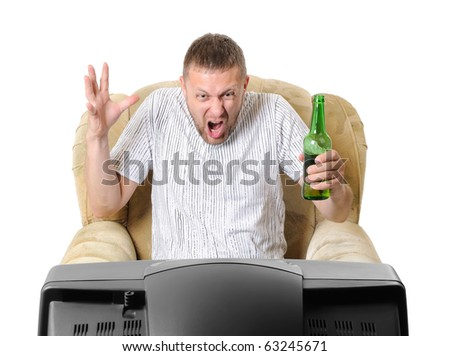 The man with beer in an armchair watches TV isolated on withe background - stock photo