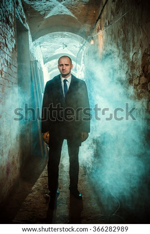 The man with black coat - stock photo