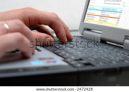 The man works on notebook - stock photo