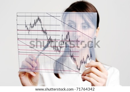 The manager looks at the chart printed on a transparent material - stock photo