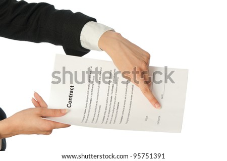 The managing director giving her partner a contract for signing - stock photo