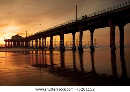 The Manhattan Beach Pier, Los Angeles under a warm California sun. - stock photo