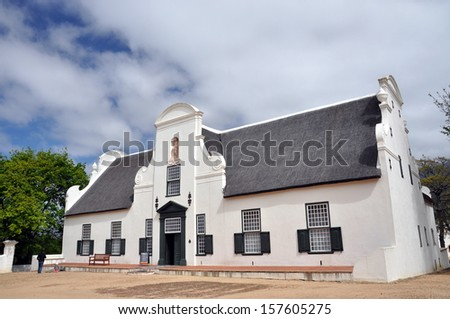 The manor house at Groot Constantia, the oldest and most historic of South Africa's wine farms. - stock photo