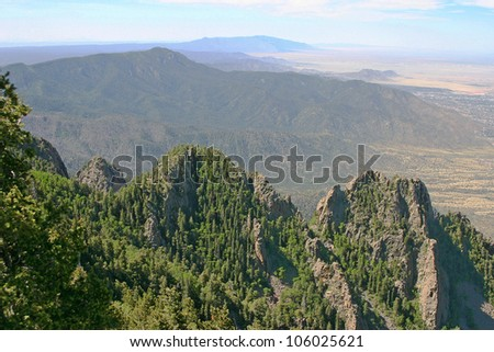 The Manzano Mountains viewed from high up in the Sandia Mountains outside of Albuquerque, New Mexico - stock photo
