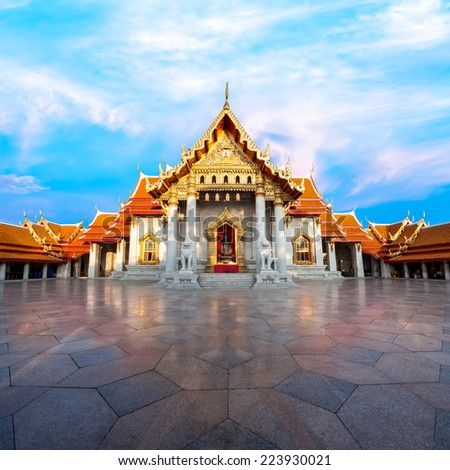 The Marble Temple with reflection under the blue sky, Wat Benchamabopitr Dusitvanaram (Bangkok, Thailand) - stock photo