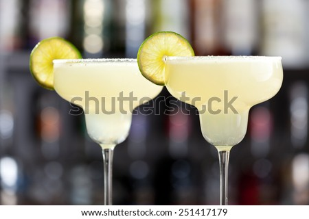 The margarita is a cocktail consisting of tequila mixed with orange-flavoured liqueur and lime or lemon juice, often served with salt on the glass rim. - stock photo