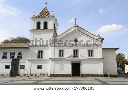 The mark zero of the foundation of the city of Sao Paulo, the white historical building chapel with a cross and a tower. Downtown Sao Paulo, Brazil. - stock photo