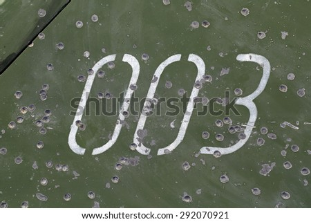 The marks of bullets and shrapnel on Board the armoured military vehicle - stock photo