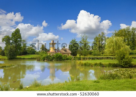 The Marlborough Tower and pond in Marie-Antoinette's estate. Versailles Chateau. France - stock photo