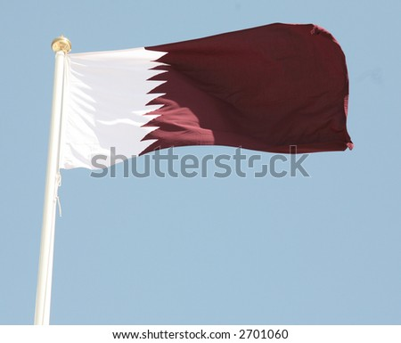 The maroon and white national flag of the Arab Gulf State of Qatar. - stock photo