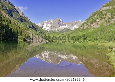 The Maroon Bells reflecting in Lake, Elk Mountains, Colorado - stock photo