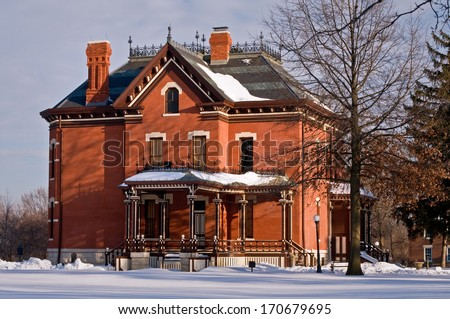 The Martin Mitchell Mansion in winter at the Naper Settlement in Naperville, Illinois. - stock photo