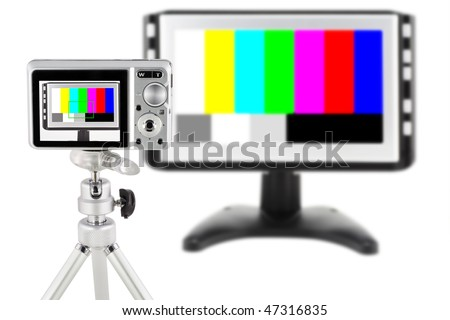 The mass compact digital camera test. The target is the modern TV with the color test sheet. Isolated on white. Contains clipping path of objects and screen. - stock photo