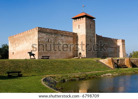 The massive Gothic square castle at Gyula, (near the thermal baths), the only medieval brick-built best-preserved chapel in Hungary castle. - stock photo