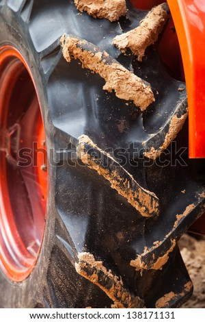 The massive tire of an agricultural machine - stock photo