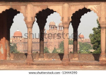 The massive walls and entrance to the Red Fort as seen from the courtyard of the main mosque in Old Delhi, India - stock photo