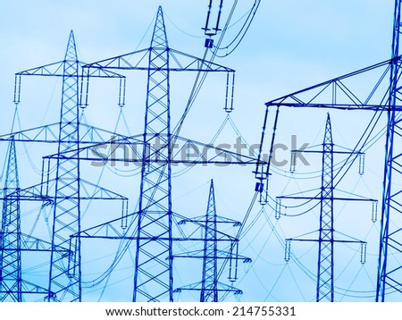 the mast of a high voltage power line for electricity before dark clouds. - stock photo