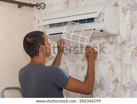 the master cleans the filters in the air conditioner