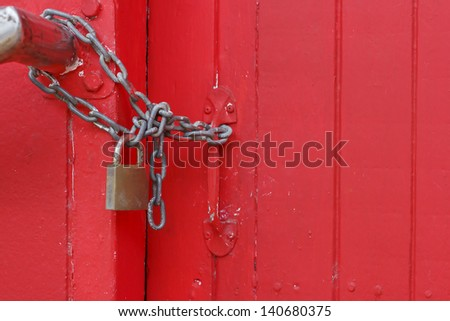 The master key and chain locked on the gate - stock photo