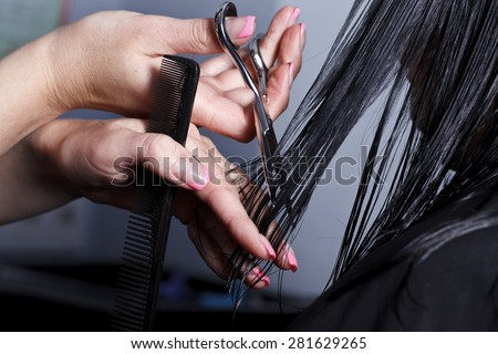 The master the hairdresser does a hairdress in salon - stock photo