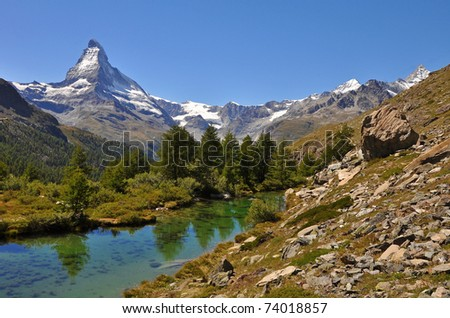 The Matterhorn reflecting in the Stellisee / lake, swiss alps - stock photo