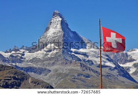 The Matterhorn with the swiss flag - stock photo
