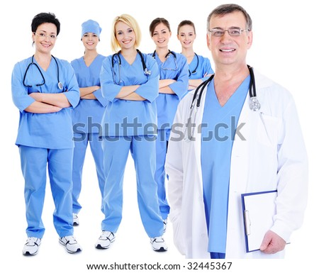 the mature experienced doctor with his colleagues at the background