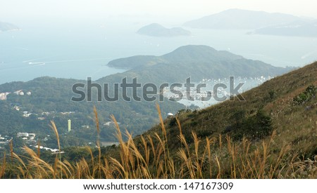 the meadow front bird view with the Inland Sea background in Sai Kung suburb from Mount Ma On Shan in Hong Kong - stock photo