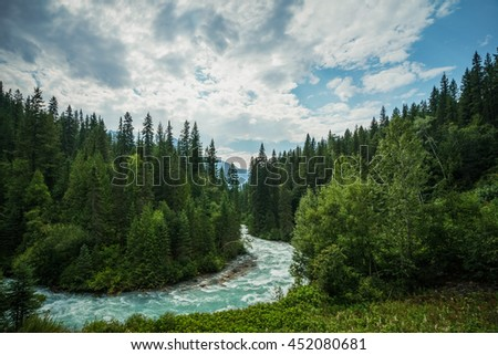 The meandering aqua waters of the fRobson River near Mount Robson, British Columbia, Canada - stock photo