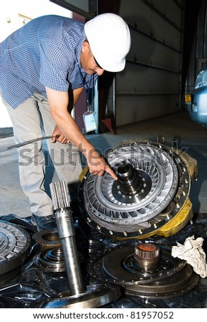 The mechanic shows on a detail - stock photo